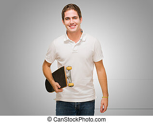 Young Man Holding Skate Board
