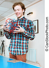 Young Man Holding The Volumetric Model Of Geometric Solid