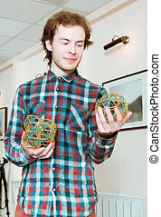 Young Man Holding The Volumetric Models Of Geometric Solids