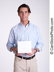 Young man holding your product
