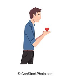 Young man holds a heart. Vector illustration.