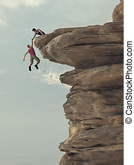 Young man holds out a hand of a climber