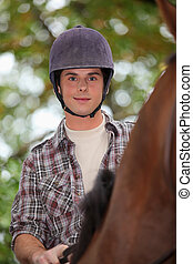 Young man horse riding