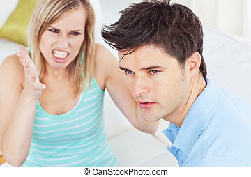 young man ignoring his girlfriend getting worked up both...