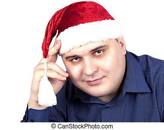 young man in a blue shirt and in a cap of Santa Claus