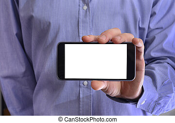 Young man in a blue shirt is holding a phone with the white scre
