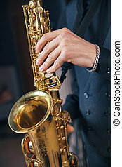 Young man in a suit hold saxophone - Young man in a suit...