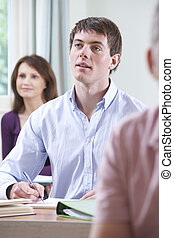 Young Man In Adult Education Class