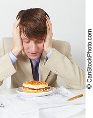 Young man in an anticipation of eating of hamburger