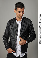 Side View Portrait Of A Sad Fashion Man In Leather Jacket