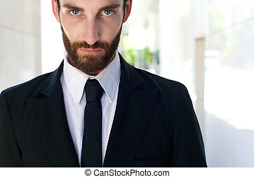 Young man in black suit and tie
