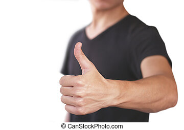 Young man in black t shirt shows thumb up. Isolated on white background.