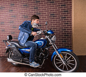 Young Man in Blue Jacket on his Sports Motorbike