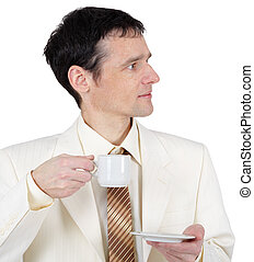 Young man in business suit with cup of coffee