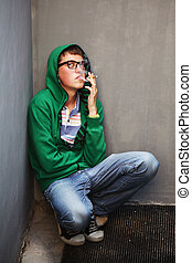 Young man in depression smoking a cigarette