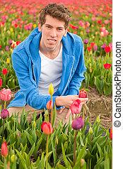 Young man in Dutch tulip fields