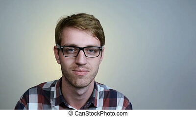 Young man in glasses - Closeup portrait of young man in...