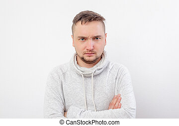 Young man in hoodie angry brow knits