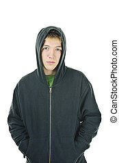 Young man in hoodie - Serious young man standing wearing...