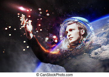 Young man in imaginary space suit stretches a hand to the...