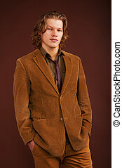 Young man in  jacket  isolated on brown background