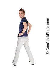 Young man in jeans standing from the back
