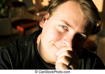 Young man in natural light - Portrait of a man with blue...
