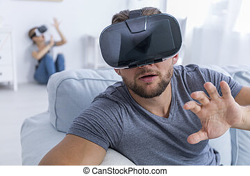 Young man in new VR glasses