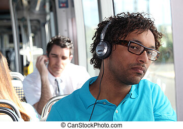 young man in public transportation