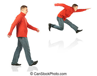 Young man in red sweater goes and jumps