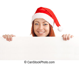 Young man in santa hat holding a blank sign