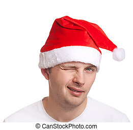 Young man in santa hat winking
