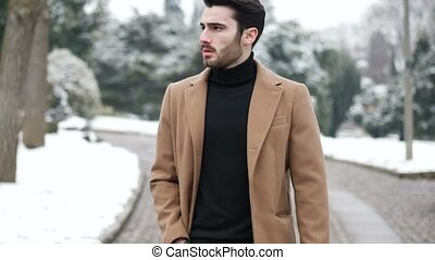 Young man in snowy city in Italy