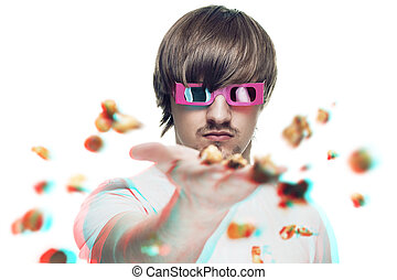 young man in stereo glasses throwing popcorn at the viewer...