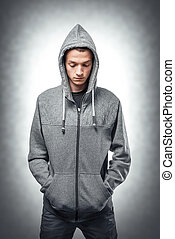 Young man in stylish sweatshirt