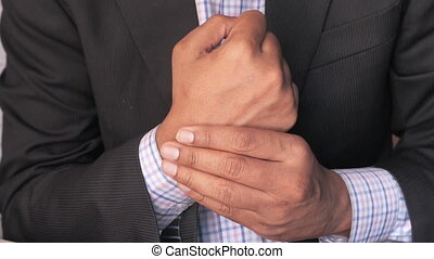 Young man in suffering wrist pain, close up.