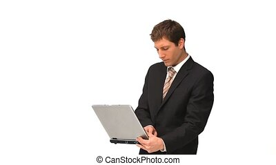 Young man in suit holding a laptop