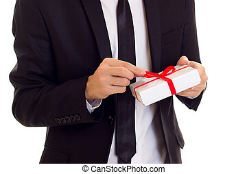 Young man in suit holding a present