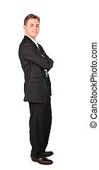 Young man in suit posing cross hands