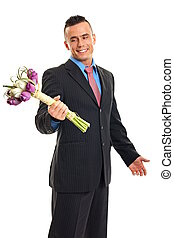 Young man in suit with tulips