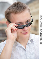 young man in sunglasses indoor