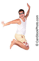 young man in sunglasses jumps