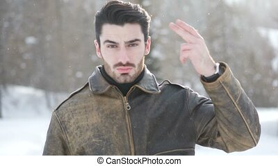 Young man in the mountain in snow