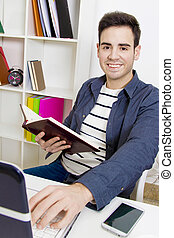 young man in the office or home working or studying