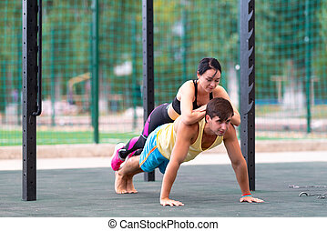 Young man in the yoga plank position