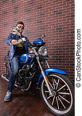 Young Man in Trendy Fashion on his Motorbike