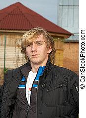 Young man in village. October 2006. Novosibirsk area