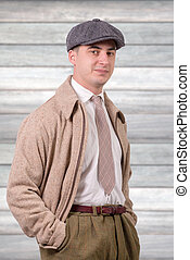 young man in vintage clothes with hat, 1940 style