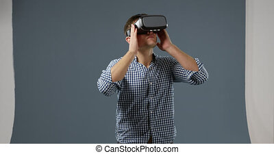 Young man in VR headset