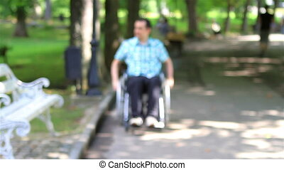 Young man in wheelchair alone